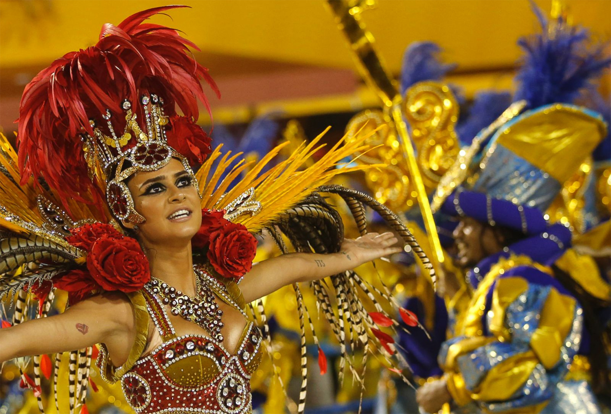 A samba performer dances during carnival celebrations at the Sambadrome in Rio de Janeiro, Brazil